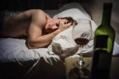 Hangover Man with Headaches in a Bed at Night — Stock Photo
