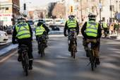 Four Cops using Bike for Fast and easy Moving. — Stock Photo