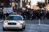 Police Car in front of the Protesters controlling the Traffic — Stock Photo