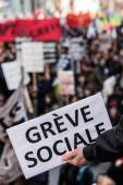 """Someone Holding a Sigh Saying """"Greve Sociale"""" (French) with Blu — Stock Photo"""