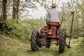 Young Farmer on a Vintage Tractor — Stock Photo