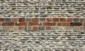 Brick and flintstone wall — Stock Photo