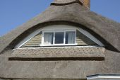 Eyebrow window in thatched roof — Foto Stock