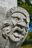 Ugly stone face sculpture — Stock Photo