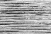 Old wall from wooden logs of black-gray color — Stock Photo