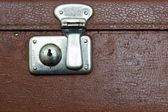 Closed lock of an old suitcase dark brown color — Stock Photo
