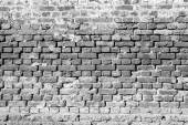 Ancient brick wall of monochrome tone — Stock Photo
