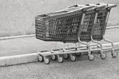 Black white baskets-carts for goods — Stock Photo