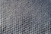 Texture brilliant fabric of black violet color — Stock Photo