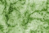 Slush from pieces of snow and ice green color — Stock Photo
