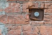Iron plate and nut on a old brick wall — Stock Photo