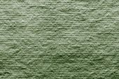 Texture wadded fabric of green color — Stock Photo