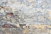 Brick wall with old plaster — Stock Photo