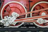 Wheels closeup retro locomotive of red color — Stock Photo