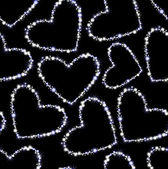 Vector seamless pattern with hearts made of snowflakes — Διανυσματικό Αρχείο