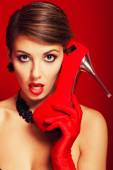 Beautiful girl with a red shoe — Stock Photo