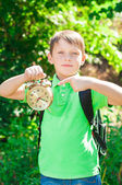 Boy with a backpack and a clock in hands — Foto de Stock