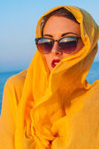 Girl with glasses and a yellow scarf — Stock fotografie
