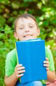 The boy with the book in hands — Stockfoto