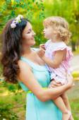 Young mother and little girl smiling — Stock Photo