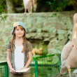 Little girl at the zoo with  pelicans — Stock Photo #52861043