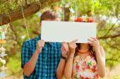 Couple girl and man with white sign in his hands — Stock Photo