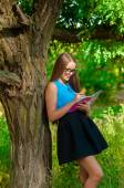 Teen girl with glasses and books in hands — Stok fotoğraf