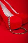 Red high heels and a necklace — Stock Photo