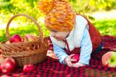 Little boy with apple in  park — 图库照片