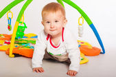 Baby boy with toys — Stock Photo