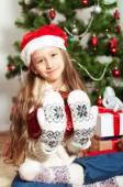 Little girl with long hair near  Christmas tree — Stock Photo