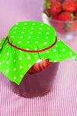 Jar of strawberry jam on  table — Stock Photo