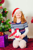 Little girl near the Christmas tree with gifts — Stock Photo