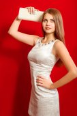 Beautiful girl  with long hair in a trendy dress and  clutch — Stock Photo