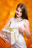 Beautiful girl with long hair with gift box — Стоковое фото