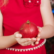 Christmas ball in the hands of little girl — Stock Photo #58242551
