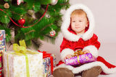 Baby in Santa costume at the Christmas — Stock Photo