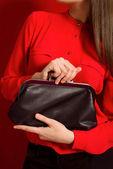 Beautiful girl with a black clutch bag — Zdjęcie stockowe