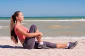 Young beautiful girl athlete playing sports on the beach — Foto de Stock