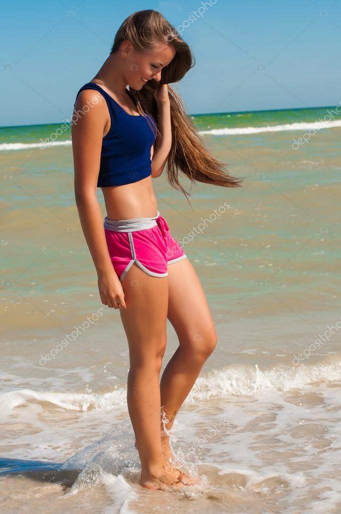 young beautiful girl athlete on the beach stock photo capable97