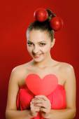 Young girl with a red heart toy in  hands — Stockfoto