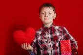 Little boy with a heart of toy and gift box — Stock Photo