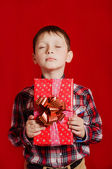 Little boy with a gift box — Stock Photo