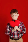 Little boy with a heart of toy — Stock Photo