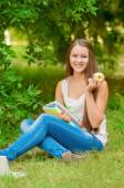Young student with books and apple — Stockfoto
