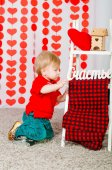 Little boy with decorations on Valentine's Day — Stockfoto