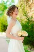 Young bride in a beautiful dress — Stock Photo