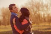 Couple young man and girl together on nature — Stock Photo