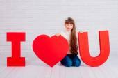 Little girl with a big  word I love you — Stock Photo
