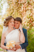 The bride and groom in summer park — Stock Photo